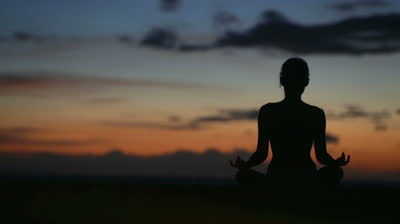 stock-footage-meditation-yoga-woman-meditating-at-beach-sunset-or-sunrise-relaxing-in-yoga-pose-serene-relaxed
